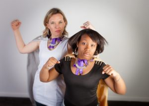 Big Sister Kara and Little Sister Ainayasha flex their muscles and pose with capes on for the Hero Campaign.